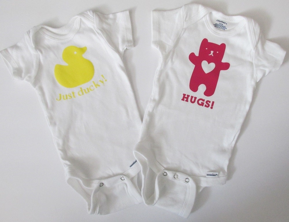 Using Cricut Explore to add vinyl to a baby onesie