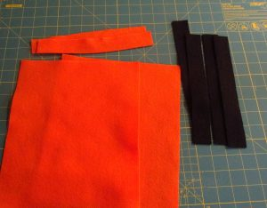 cutting felt pieces to make DIY trick or treat bag