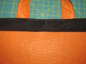 Inside top of bag side with handle sewn in. How to sew a Trick or Treat Bag.