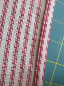 folded edge of ticking stripe tea towel