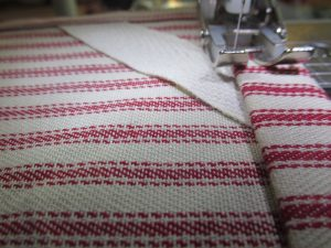 Sewing the top edge of the farmhouse towel