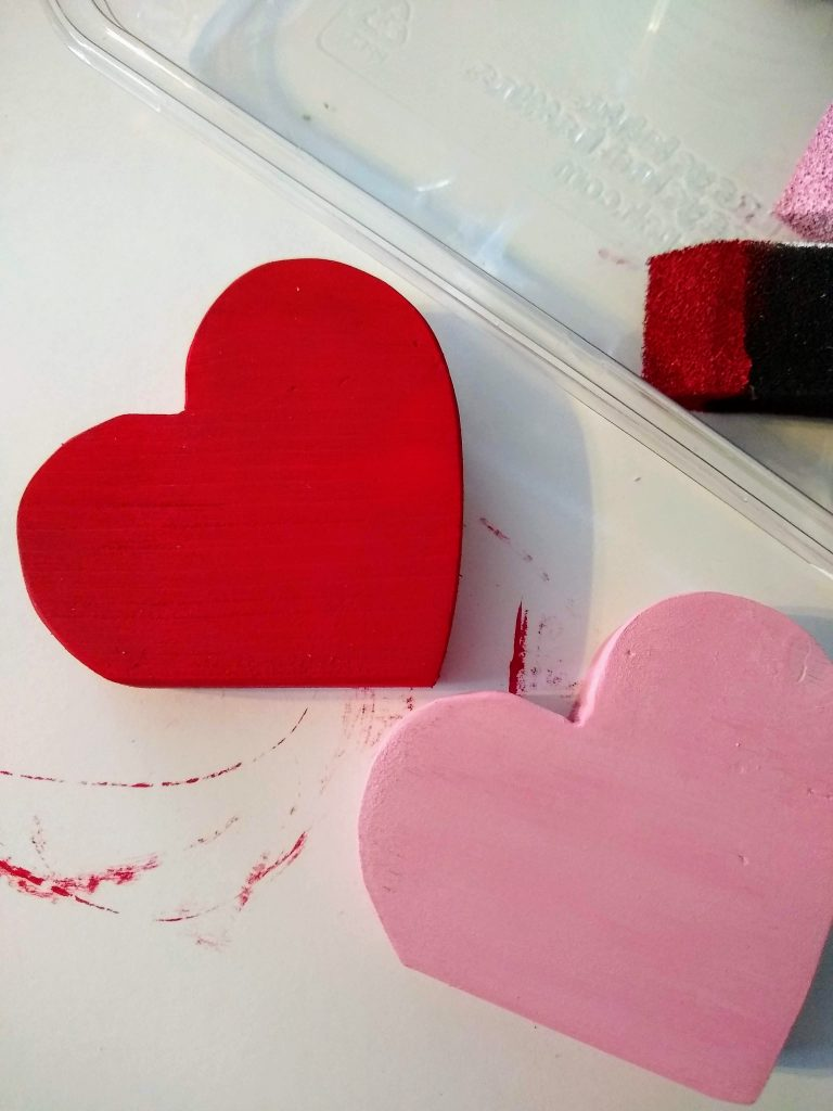 close up of painted wood hearts