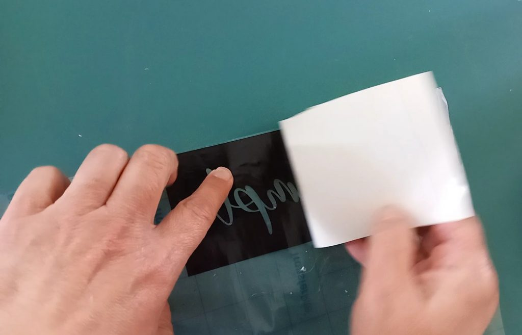 removing backing from vinyl stencil
