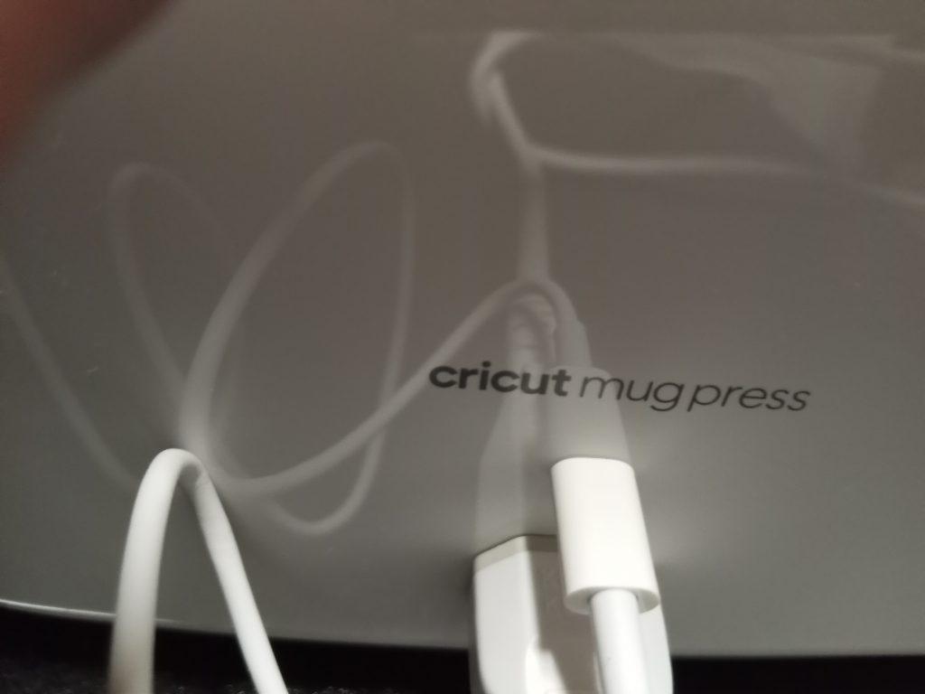 Plugging in USB cord Cricut Mug Press Setup